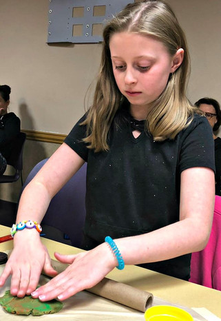 Lily learned all about how food gets from the farm to the table in the Aliante Library's Food program, and she created her own delicious dessert using play dough!  This program was provided by Engineering For Kids as a part of the library's LSTA Creation Station grant.