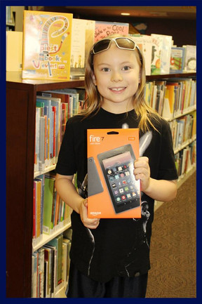 Congratulations to Odin, one of the Summer Reading Program Grand prize winners!  Odin won a Kindle Fire that he can use to keep reading by downloading books through the library.