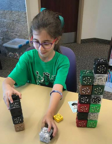 Sophia learned about coding using the Cublets blocks at a STEAM Spot at the Alexander Library.  STEAM spots can pop up at any time in the library, if you don't see one, just ask the librarian, and they can get one out for you!