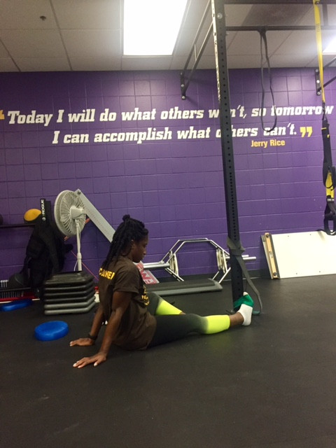Jasmyne Spencer working on her ankle's range of motion at the Orlando Pride facilities.