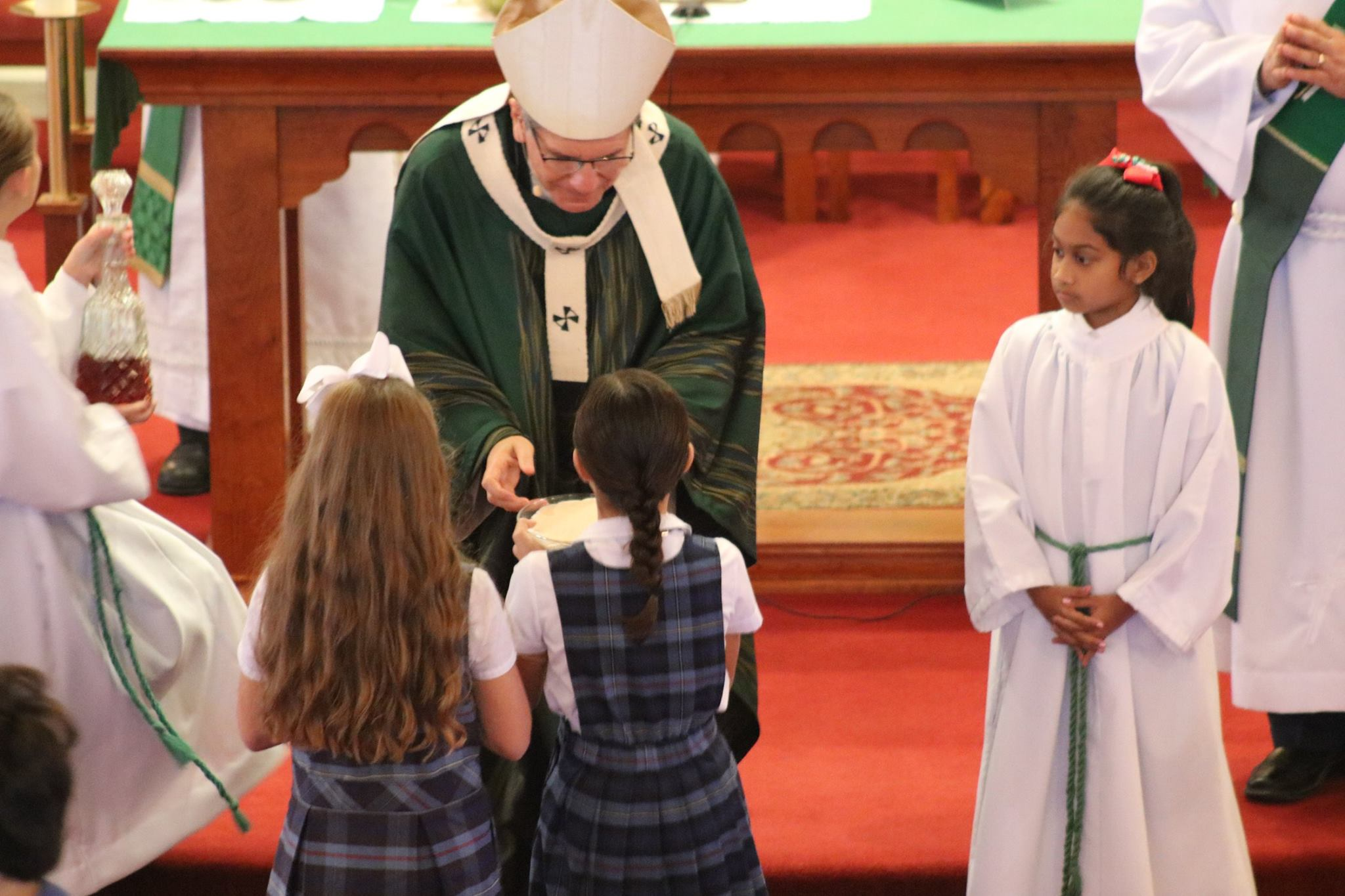 Students present gifts to Archbishop