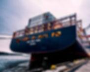 Black Sail Ship on Body of Water.jpg