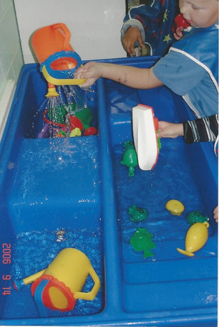 Playing at the water table.