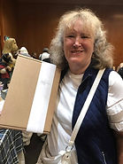 Lady at Hugglets 2017 with New Loved Before Purchase Showing Off Packaging