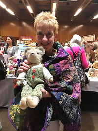 Lady Showing her Antique Bear She Purchaed at Loved Before