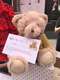 Pipa the teddy bear on display with he story