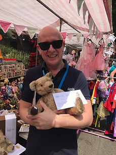 Man with his New Second Hand Teddy Bear