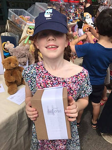 Little Girl Showing off her new Soft Toy Loved Before