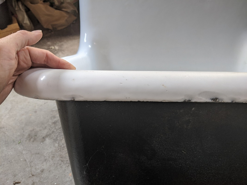 Porcelain Chips on the Edge of a 1956 Crane Utility Sink