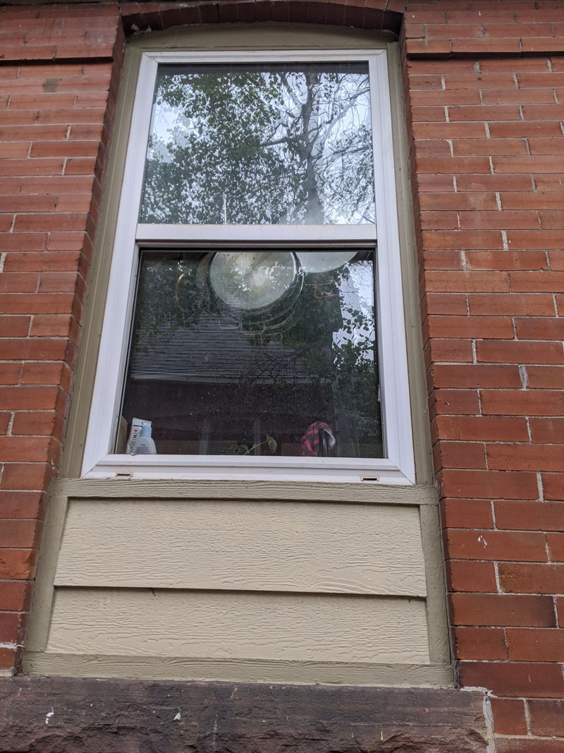 Replacement Vinyl Window with Wooden Filler at Bottom