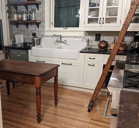 Antique farmhouse sink, walnut table and library ladder are antiques sourced by Denver Squared
