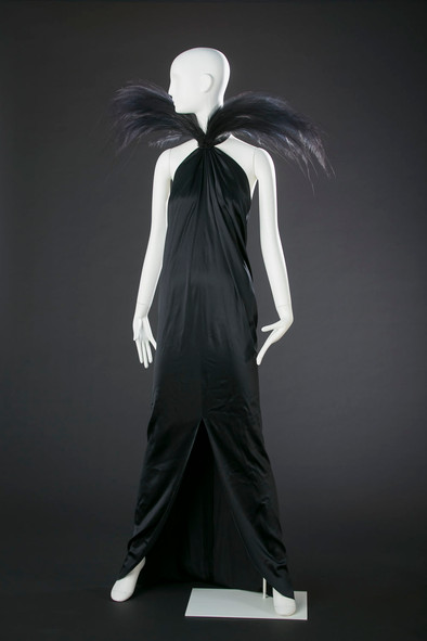 Yves Saint-Laurent Evening gown in black silk, decorated with two aigrettes 1979