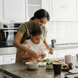 mother-and-daughter-preparing cooking-avocado-to