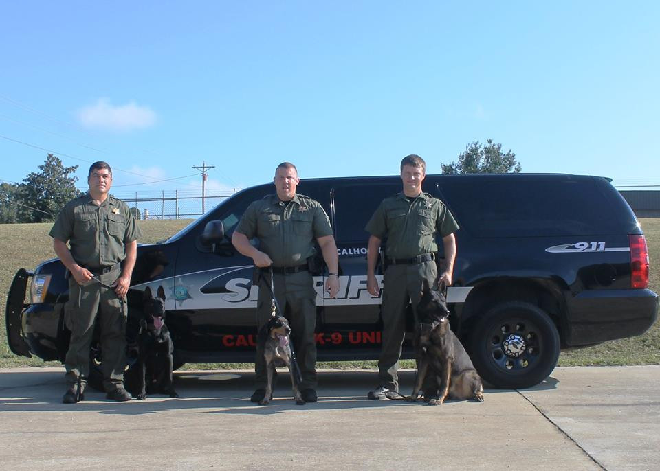 Pictured (L-R):  Deputy Adam Clayton and Angus, Sergeant Chris Golden and Blue, and Deputy Patrick Mangum and Axel.  Photo courtesy of Calhoun County Sheriff's Office.