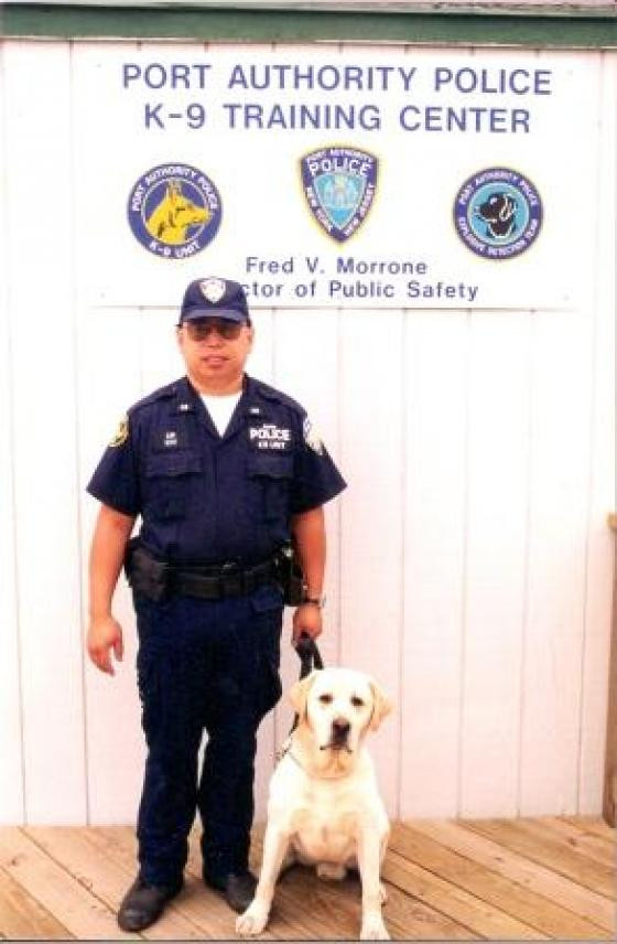 Pictured:  Lt Ken Lim, PAPD and Sirius.    Photo courtesy of https://www.911memorial.org/
