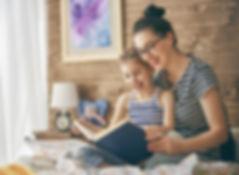mother-reading-a-book-PS3ZBTD.jpg
