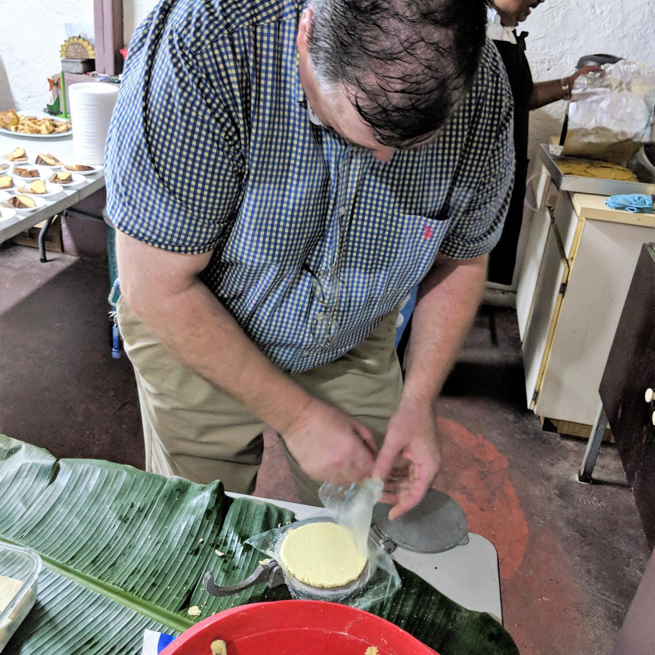 Kevin helps make tortillas