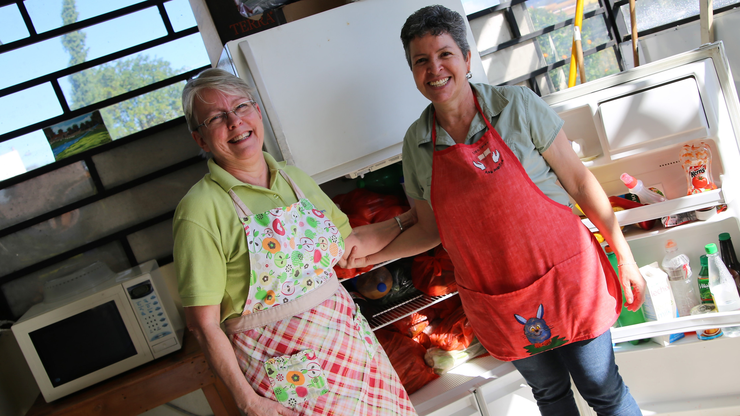 Kitchen crew (our heroes!) Debby and Elsa (yes, I know the refrigerator is open!)