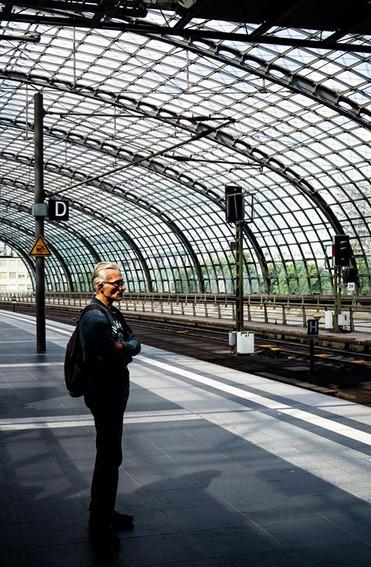 A man awaits his train
