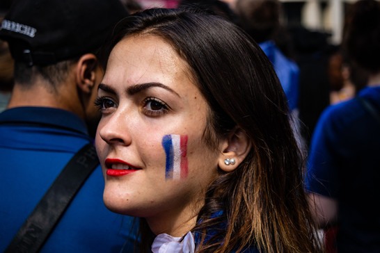 Parisian woman with facepaint for the World Cup