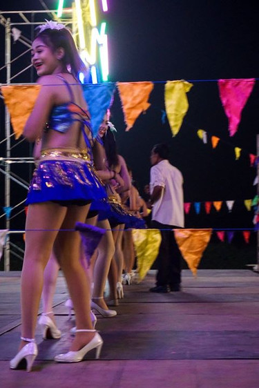 Dancers on stage at a night market.