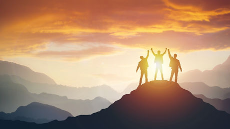 Group of peoples on mountains top in win