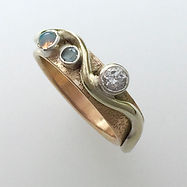 Wave Engagement ring in 9k gold with Diamond and Aquamarine