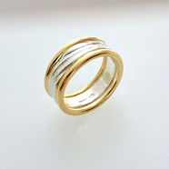 Flow wedding band in 18k yellow gold and silver.jpg