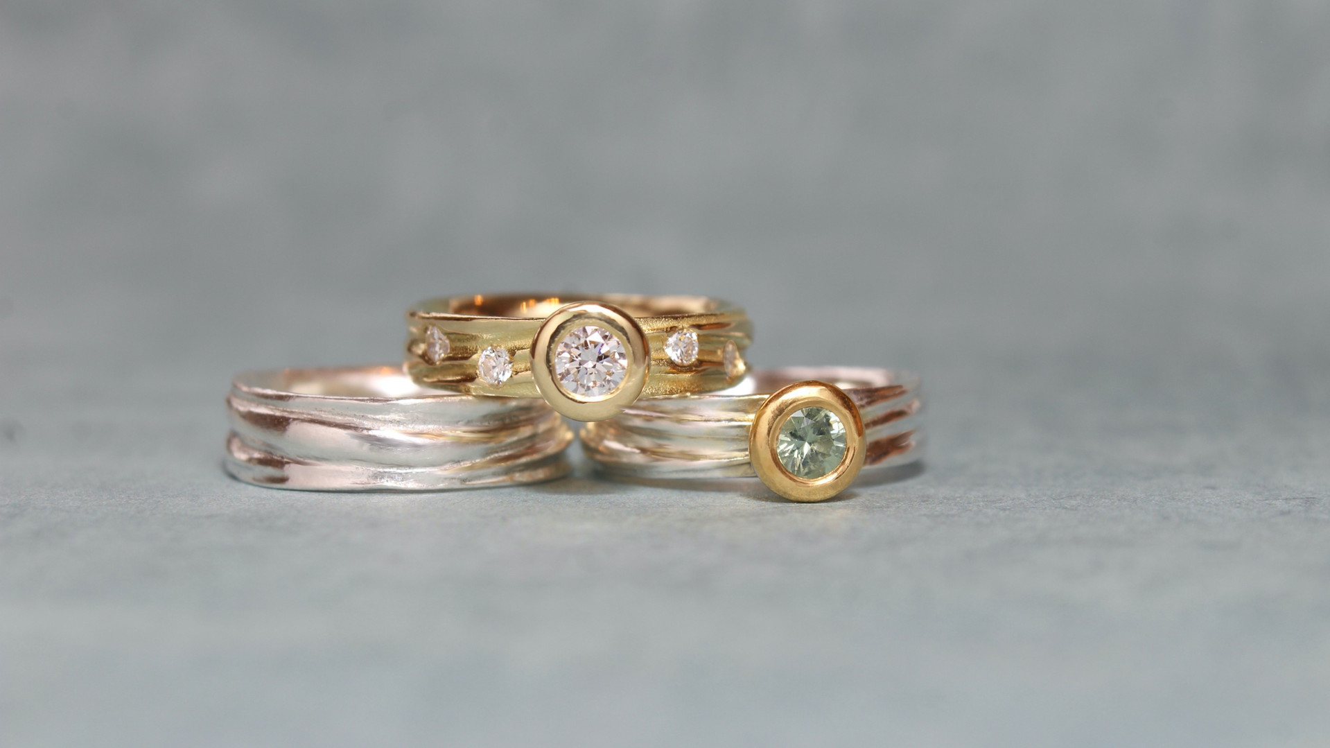 Flow Diamond and Sapphire Engagement rings with Flow wedding band