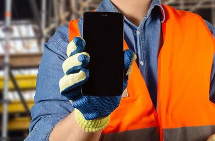 Worker Holding Phone Shutterstock.jpg
