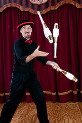 Juggler with white pins wearing black