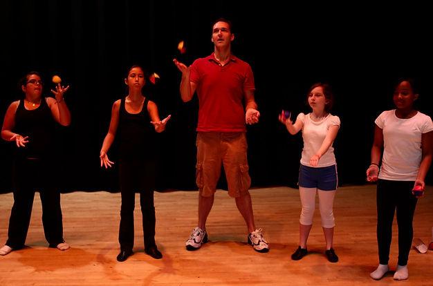 Juggler teaching Children