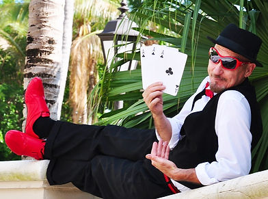 Magician holding cards