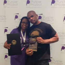 LaTasha C. Watts & DMC with Award and Book