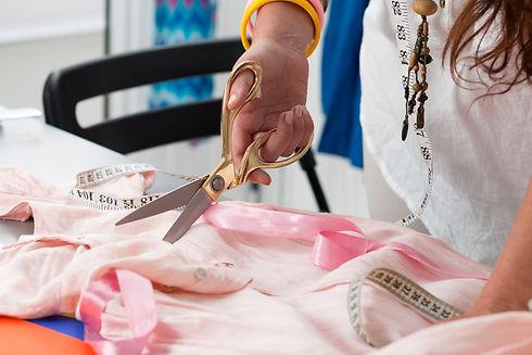 Close up view of female dress maker hand