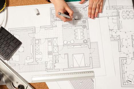 Architect-works-on-blueprints-409063.jpg