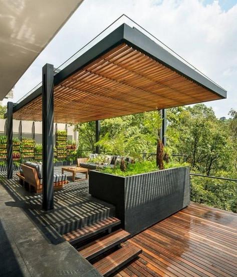Pergola bioclimatique et terrasse suspendue en paliers
