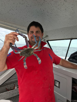 Rowey with his catch from the boat