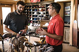 customer-explaining-golf-clubs-1325735.j