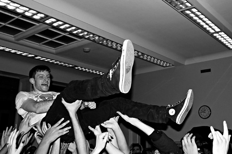 Stefan Babcock of PUP crowdsurfing - Toronto Library