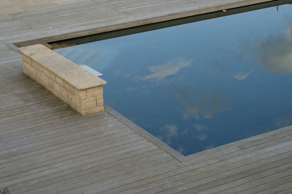 Wooden deck, seat incorporating water fountain, natural pool