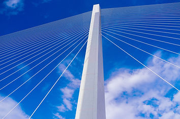 Modern bridge set against blue sky