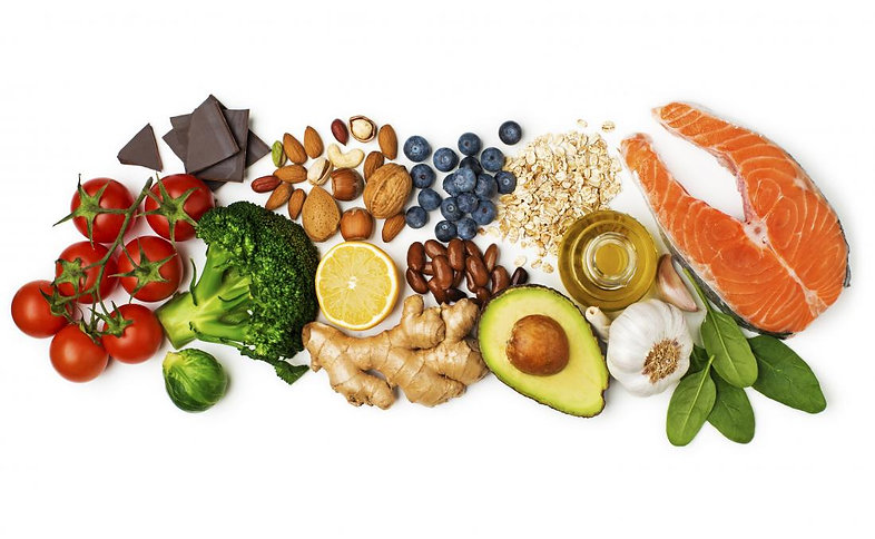 popular-healthy-foods-laid-out-on-white-