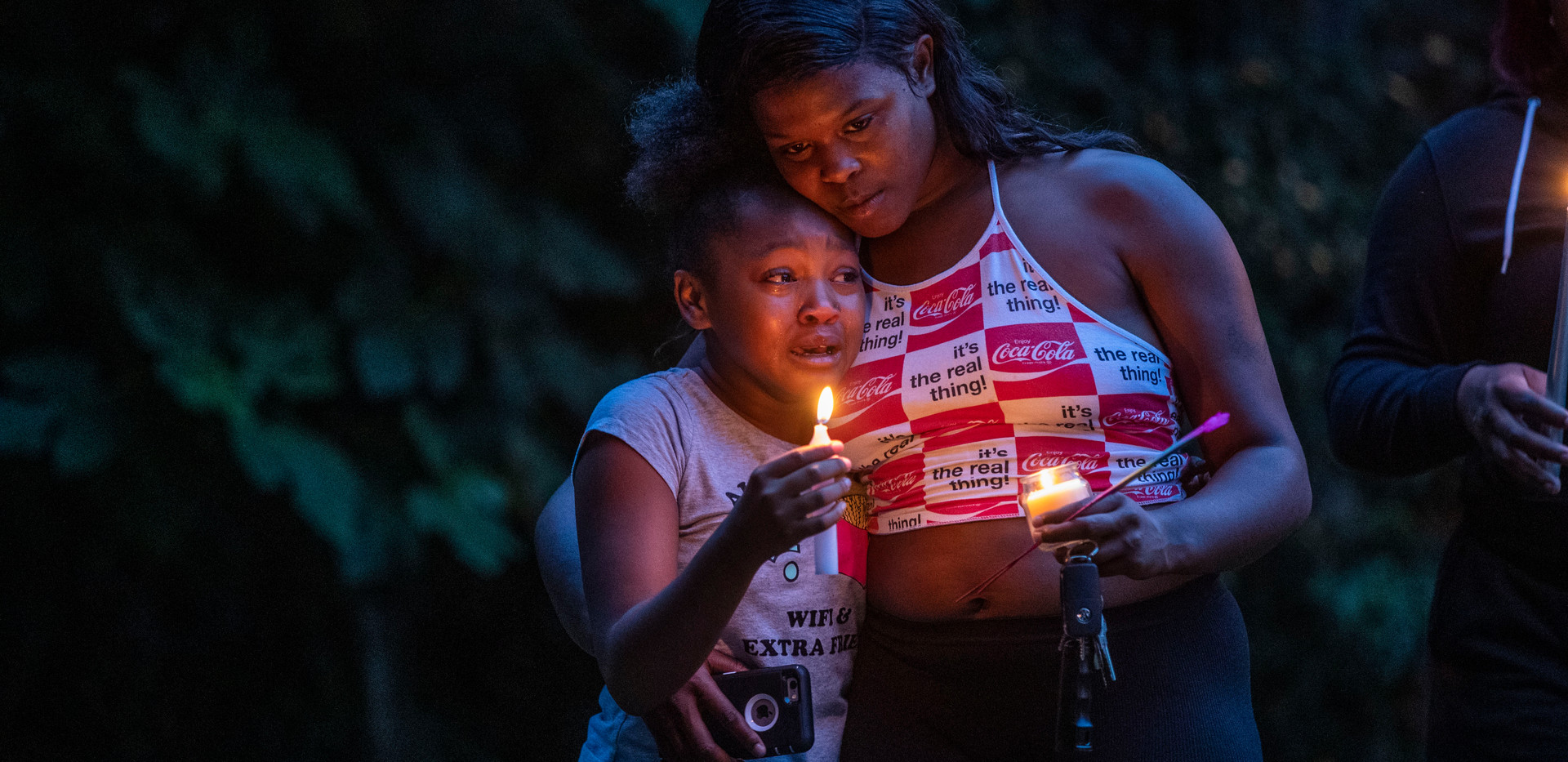 A crowd gathers as a candlelight vigil is held honoring Malik Jackson, 21, who was stabbed and killed on Wednesday, May 27, 2020.