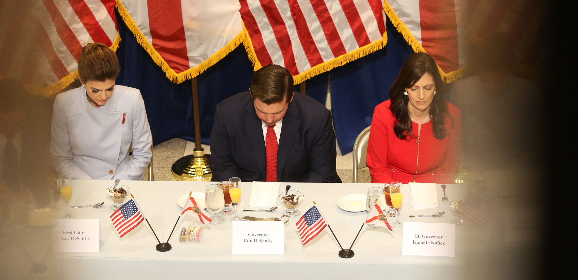 For the first time in Inaugural history, Gov. Ron DeSantis addresses Florida's Legislative leaders and Cabinet officials. DeSantis discusses his plans to work with our state's elected leaders to achieve a Bold Vision for a Brighter Future, Tuesday, Jan. 8, 2019. Gov. Ron DeSantis, left, and Lt. Gov. Jeanette Nunez, bow their head in prayer before the start of the luncheon.