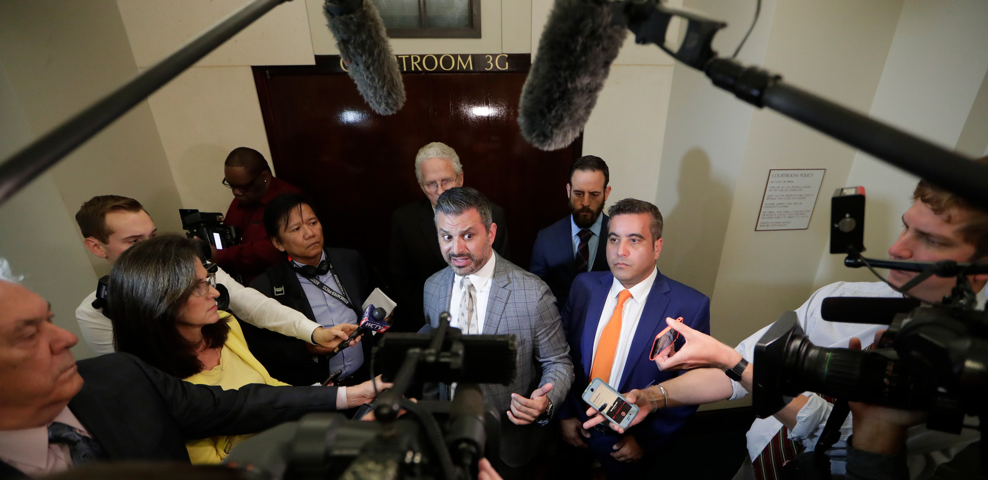 fredo Garcia's attorneys Saam Zangeneh, center, and Mauricio Padilla, right, speak with reporters Friday after Leon County jurors convicted their client for murdering Dan Markel in 2014.