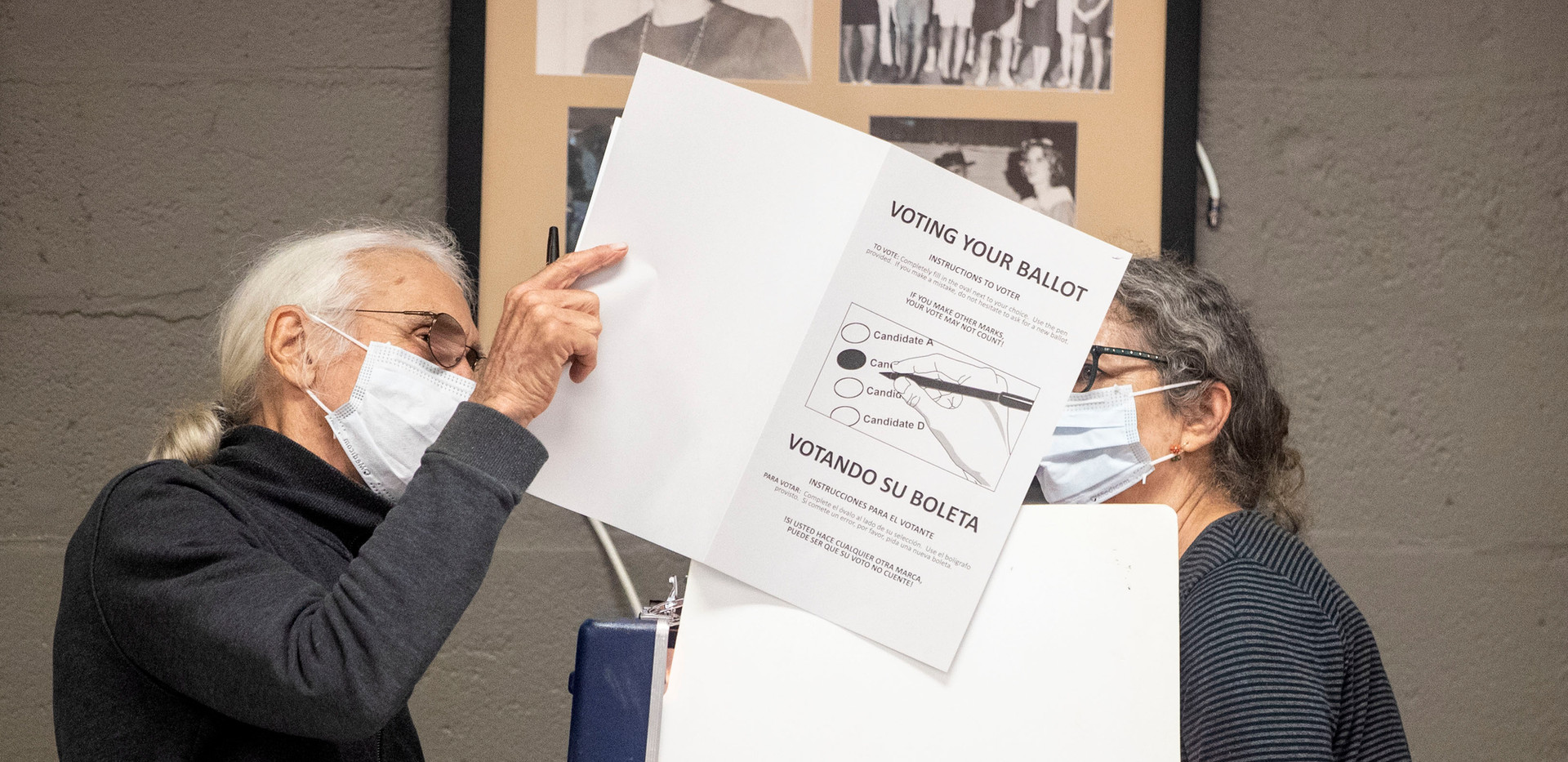 Jim Roche, left, and Alexa Kleinbard wear masks while voting in Tallahassee during the Florida primary election, Tuesday, March 17, 2020. Both are over 65-years-old and felt it was important to exercise their right to vote while also being cautious of the coronavirus.