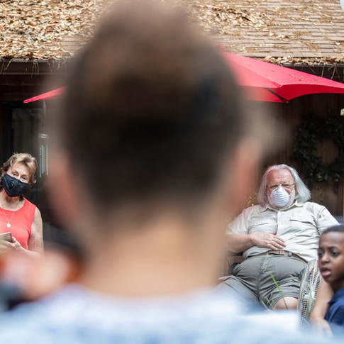 Pasty McCall, 80, left, and her husband Dick Lloyd, 70, listen as their neighbor Petra Croom, 11, performs a violin solo on their deck, Friday, April 10, 2020. Croom is one of four siblings who brought their instruments over to their neighbors' home to serenade them from a distance.