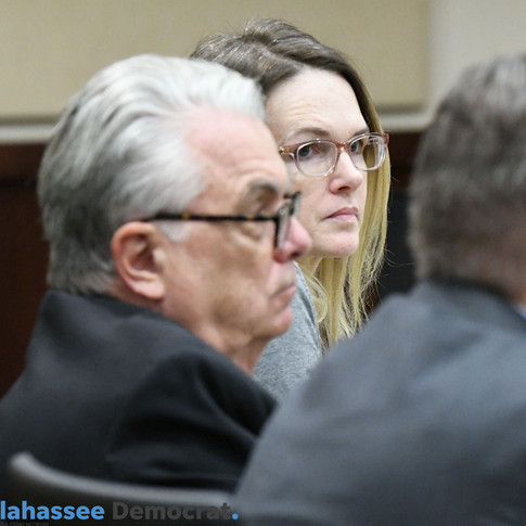Tuesday, Dec. 11, 2018, Denise Williams sits with her lawyers as she listens Alton Ranew, a retired Florida fish and wildlife conservation officer, give his testimony during the trial for the murder of her husband Mike Williams.