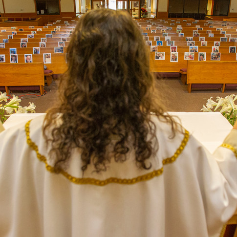 Father Tom Dillion, a priest at Good Shepherd Catholic Church located in Tallahassee, Florida, preaches to an empty sanctuary with pews covered in photographs of the congregation, Saturday, April 11, 2020.